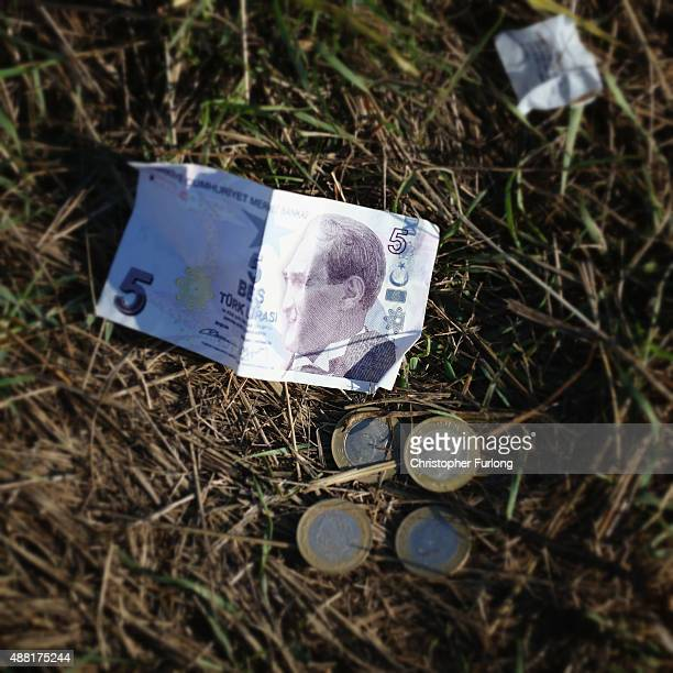 Turkish currency lays on the ground as migrants discard items no longer wanted or needed when they cross the Hungarian border on September 14 2015 in...