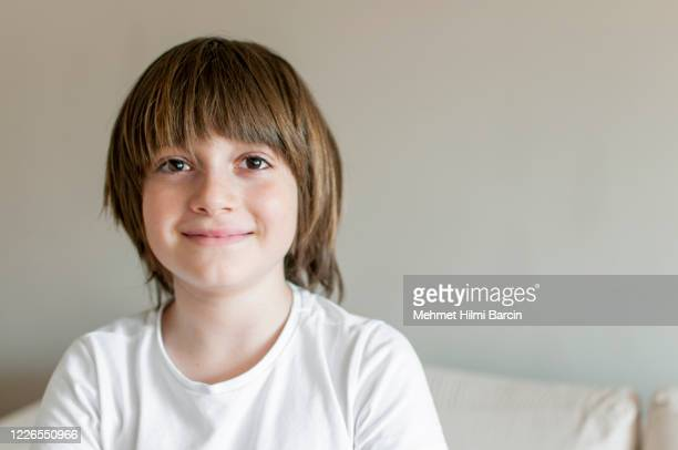 turkish cute boy posing at home - brown eyes stock pictures, royalty-free photos & images
