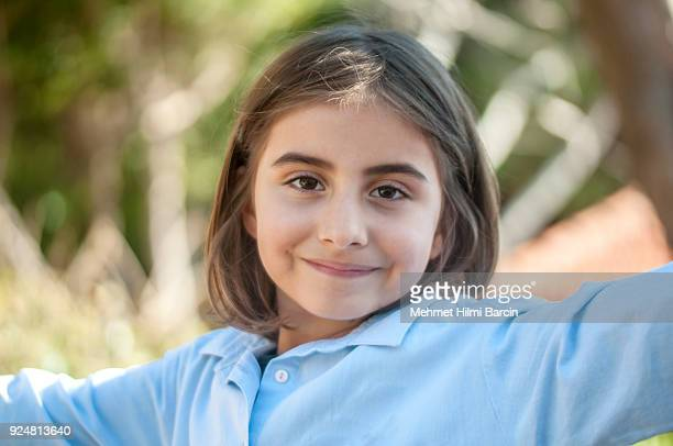 turkish cute little girl posing - beautiful turkish girl stock pictures, royalty-free photos & images