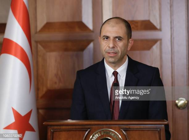 Turkish Cypriot counterpart Kudret Ozersay speaks during joint press conference with Turkish Foreign Affairs Minister Mevlut Cavusoglu in Ankara,...