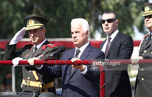 Turkish Cypriot leader Dervis Eroglu attend a military parade marking the 38th anniversary of the Turkish military invasion of Cyprus on July 20 2012...