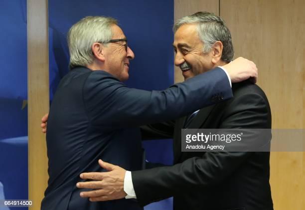 Turkish Cypriot leader Mustafa Akinci hugs with European Union Commission President Jean Claude Juncker in Brussels, Belgium on April 5, 2017.