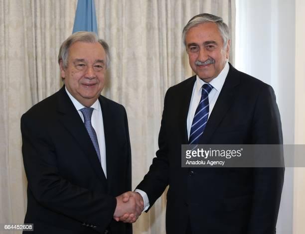 Turkish Cypriot leader Mustafa Akinci shakes hands with UN Secretary-General Antonio Guterres ahead of their meeting in Brussels, Belgium on April...
