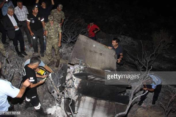 Turkish Cypriot police and inspectors check the remains of what officials said was a suspected Russian missile that exploded overnight on July 1 in...