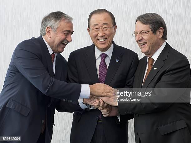 Turkish Cypriot President Mustafa Akinci Greek Cypriot leader Nicos Anastasiades and the UN SecretaryGeneral Ban Kimoon pose for a photograph prior...