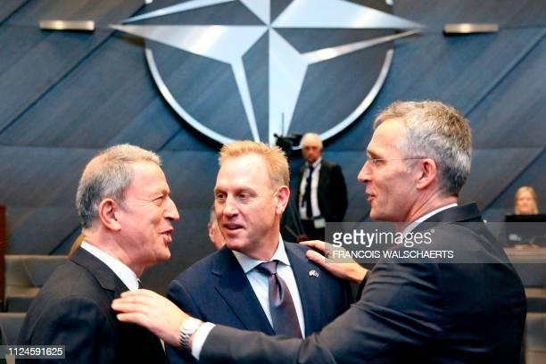 Turkish Defence Minister Hulusi Akar acting US Defence Secretary Patrick Shanahan and NATO Secretary General Jens Stoltenberg speak before the North...