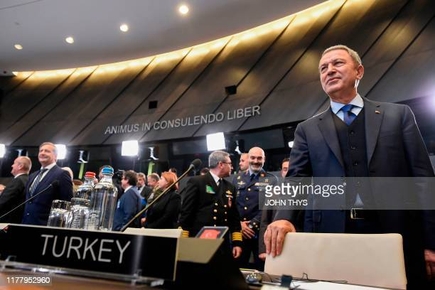 Turkish Defence minister Hulusi Akar looks on as he arrives for a NATO defence ministers meeting at the NATO headquarters in Brussels on October 24...
