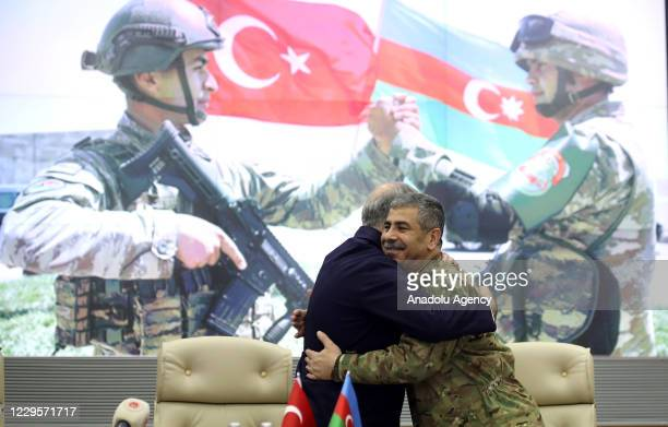 Turkish Defense Minister Hulusi Akar and Minister of Defence of Azerbaijan, Zakir Hasanov greet each other during a ceremony held for the deal...