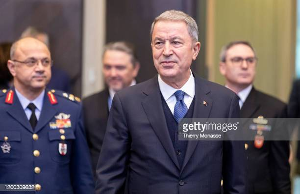 Turkish Defense Minister Hulusi Akar arrives for the first meeting of NATO ministers in the North Atlantic Treaty Organization headquarter on...