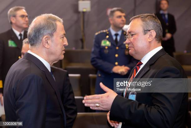 Turkish Defense Minister Hulusi Akar is talking with the Romanian Minister of National Defense Nicolae-Ionel Ciuca during the first meeting of NATO...