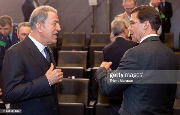 Turkish Defense Minister Hulusi Akar is talking with the United States of America Secretary of Defense Mark Thomas Esper during the first meeting of...