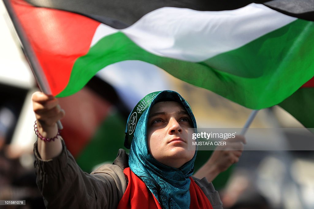 A Turkish demonstrator carries a Palestinian flag during an anti-Israeli protest in front of the Israeli Consulate in Istanbul on May 31, 2010. Israeli warships stormed of flotilla of aid ships, among them Turkish vessels, early on May 31, killing between 10 and 15 people and wounding 30 others off the coast of the Gaza Stip. Turkey condemned the attack, saying the Israeli operation may lead to 'irreparable consequences' in bilateral ties.