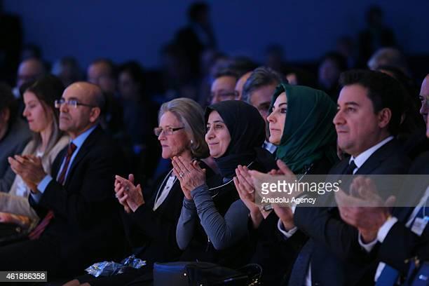 Turkish Deputy Prime Minister Ali Babacan and his wife Zeynep Babacan Turkish Prime Minister Ahmet Davutoglu's wife Sare Davutoglu applaud as Turkish...