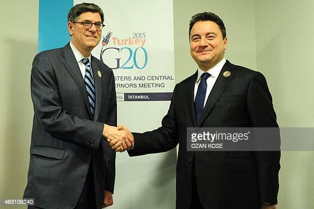Turkish Deputy Prime Minister Ali Babacan and US Treasury Secretary Jack Lew shake hands during the G20 finance ministers and central bank governors...