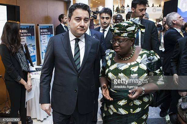 Turkish Deputy Prime Minister Ali Babacan speaks with Nigerian Finance Minister Ngozi OkonjoIweala before the International Monetary and Financial...