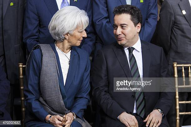 Turkish Deputy Prime Minister and G20 Chair Ali Babacan speaks with IMF Managing Director Christine Lagarde before the family photo with the IMF...