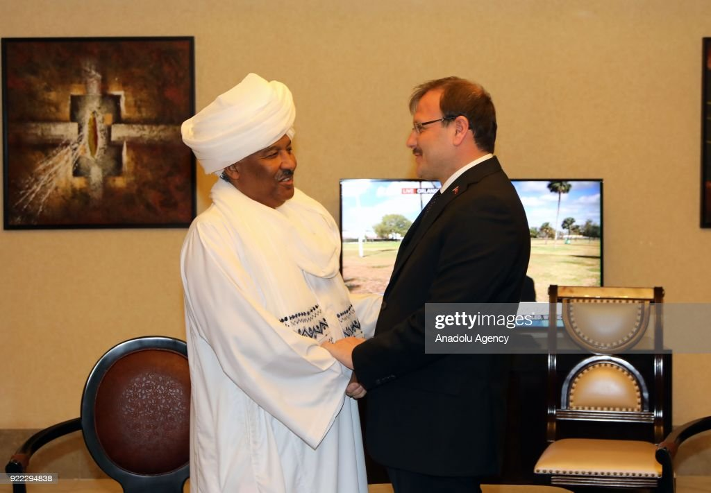 Turkish Deputy Prime Minister Hakan Cavusoglu (R) shakes hands with Sudanese Minister of International Cooperation Suleiman Youssef (L) ahead of their meeting in Khartoum, Sudan on February 20, 2018.
