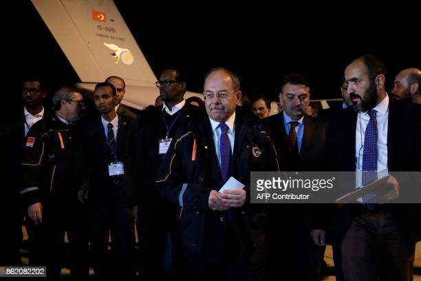 Turkish Deputy Prime Minister Recep Akdag arrives at the airport for the landing of a Turkish military plane in which Somalians wounded from the...