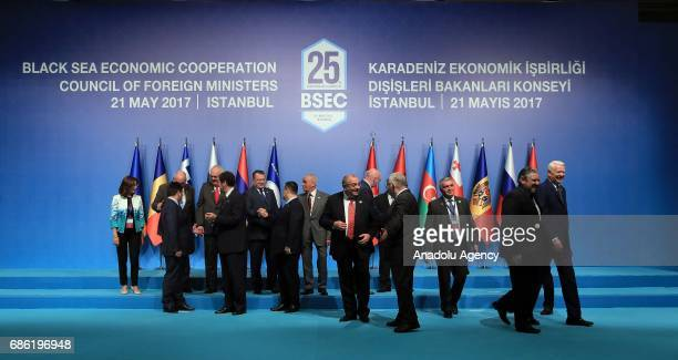 Turkish Deputy Prime Minister Tugrul Turkes and other leaders prepare to pose for a family photo during the Organization of the Black Sea Economic...