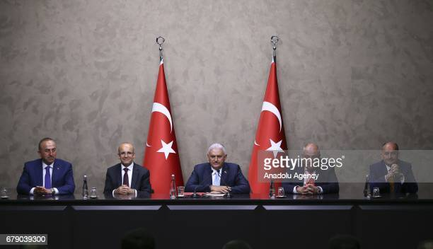 Turkish Deputy Prime Ministers Mehmet Simsek and Tugrul Turkes Turkish Foreign Minister Mevlut Cavusoglu and Turkey's new Labor and Social Security...