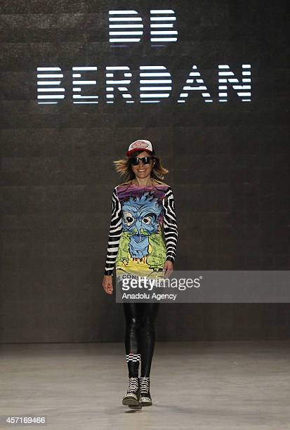 Turkish designer Deniz Berdan is on the stage after models display her creation on the first day of MercedesBenz Fashion Week Istanbul at Antrepo 3...