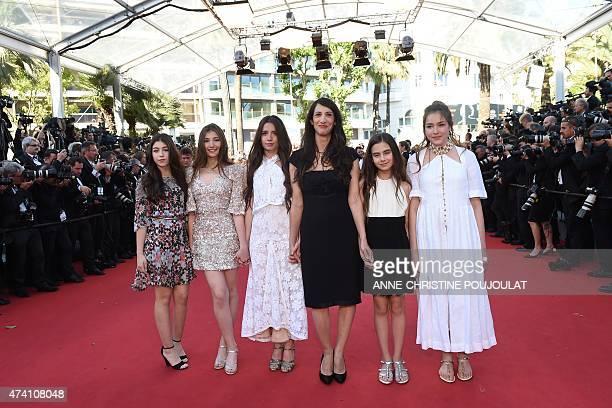 Turkish director Deniz Gamze Erguven poses with Turkish actresses Doga Zeynep Doguslu Ilayda Akdogan Elit Iscan Gunes Sensoy and Tugba Sunguroglu as...