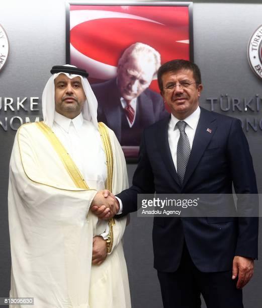 Turkish Economy Minister Nihat Zeybekci and Qatari Minister of Economy and Commerce Sheikh Ahmed Bin Jassim alThani shake hands as they pose for a...