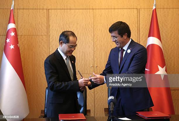 Turkish Economy Minister Nihat Zeybekci and Singaporean Trade and Industry Minister Lim Hng Kiang prepare to sign joint declaration on free trade...