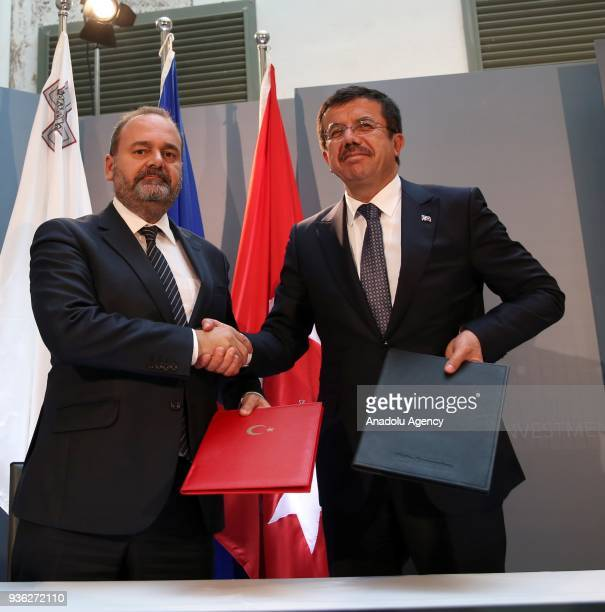 Turkish Economy Minister Nihat Zeybekci shakes hands with Economy Minister of Malta Christian Cardone after signing the JETCO 1st Term Protocol...