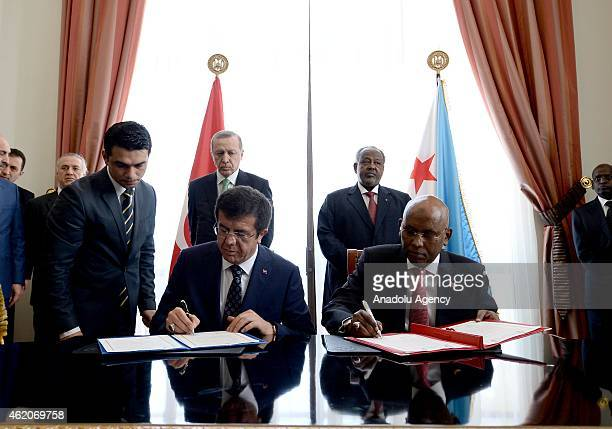 Turkish Economy Minister Nihat Zeybekci signs a cooperation protocol with his Djibouti counterpart Ilyas Dawaleh Moussa as Turkish President Recep...