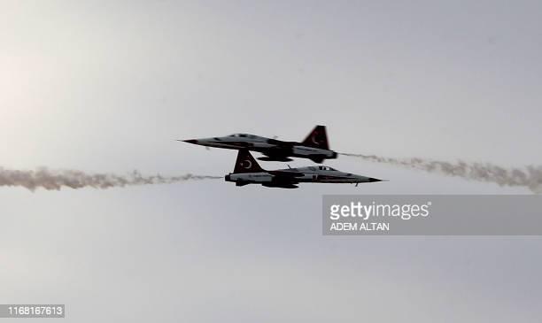 Turkish elite acrobatic flying team 'Turkish Stars' performs a flying display during the Sivrihisar airshow in Sivrihisar district of Eskisehir on...