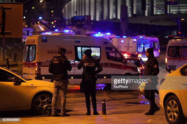 Turkish emergency workers and police officers are seen on the site where a car bomb exploded near the stadium of football club Besiktas in central...