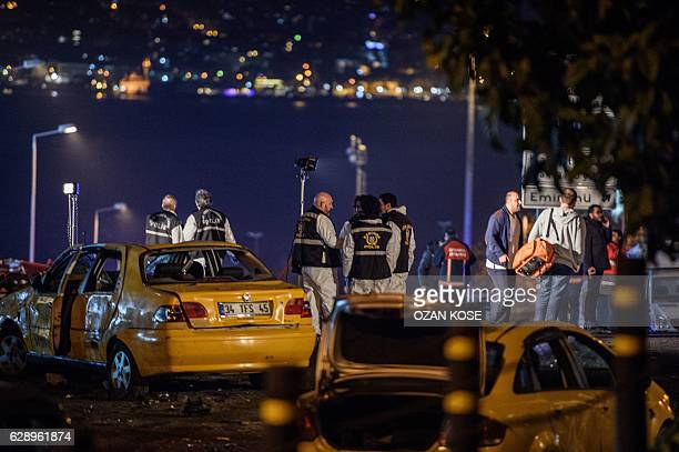 Turkish emergency workers police officers and forensic work on the site where a car bomb exploded near the stadium of football club Besiktas in...