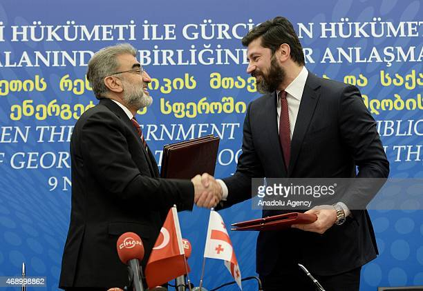 Turkish Energy Minister Taner Yildiz shake hands with Georgian Deputy Prime Minister and Energy Minister Kakha Kaladze after signing of agreement on...