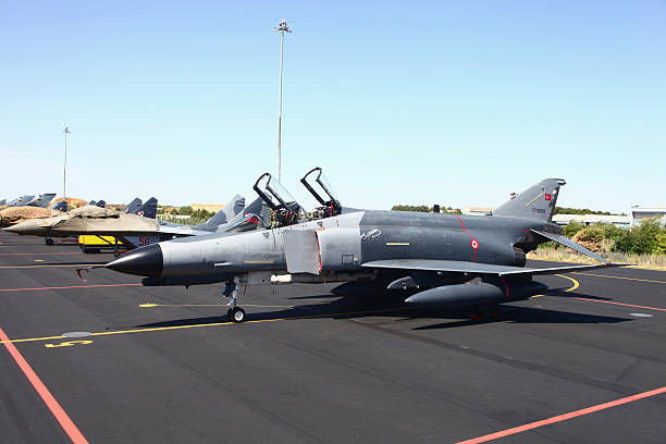 Turkish F-4E Phantom together with Polish MiG-29`s on the ramp at Albacate Airfield, Spain, during NATO's Tactical Leadership Program exercise.