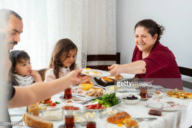 turkish family eating breakfast at home - turkey middle east stock pictures, royalty-free photos & images