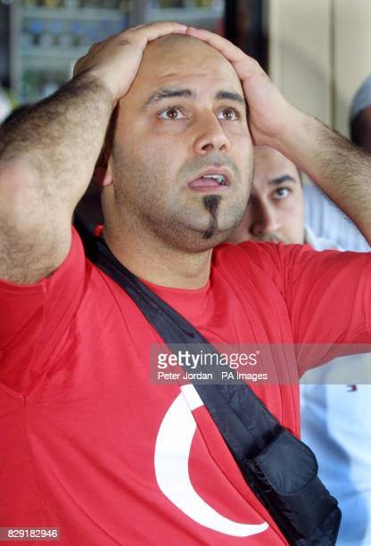 A Turkish fan watches as his team are knocked out of the World Cup by Brazil during a live televised match of the Semifinals in Green Lanes north...