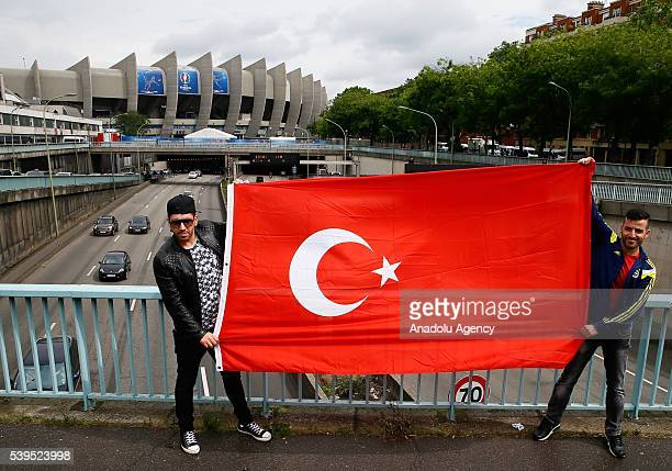 Turkish fans pose for a photograph ahead of the EURO 2016 Group D football match beetween Turkey and Croatia in front of the Parc des Princes stadium...