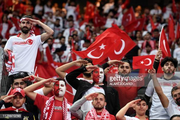 Turkish fans salute before the Euro 2020 Group H qualification football match between France and Turkey at the Stade de France in SaintDenis outside...