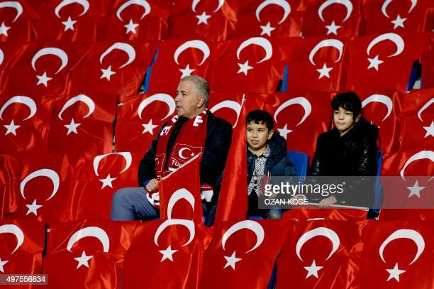 Turkish fans wait with Turkish flags before the start of the friendly football match between Turkey and Greece at Basaksehir stadium on November 17,...