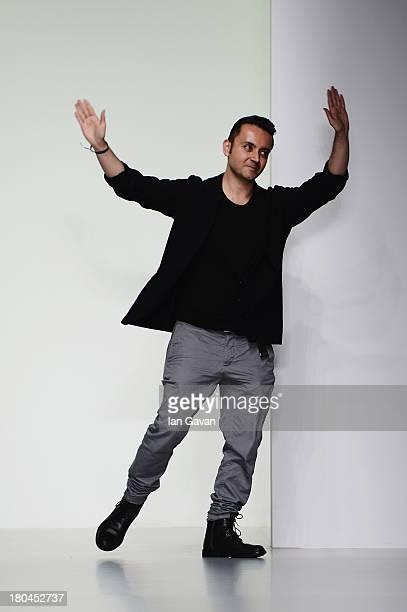 Turkish fashion designer Bora Aksu acknowledges the crowd following his show during London Fashion Week SS14 at Somerset House on September 13, 2013...