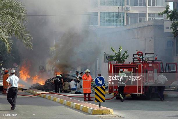 Turkish firefighters extinguish a blaze 19 July 2006 after a police helicopter crashed for an unknown reasons in the southern Turkish city of Antalya...