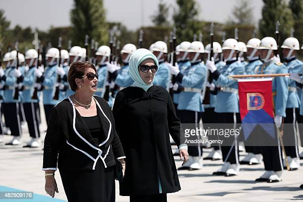 Turkish First lady Emine Erdogan and GovernorGeneral of Australia Peter Cosgrove's wife Lynne Cosgrove walk past a guard of honor during an official...