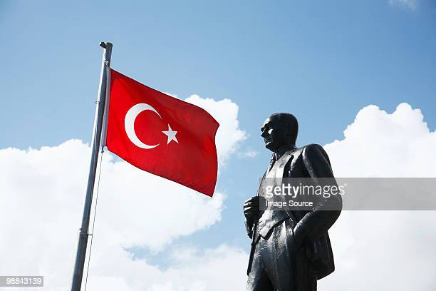 turkish flag and ataturk statue in kas, turkey - ataturk stock photos and pictures