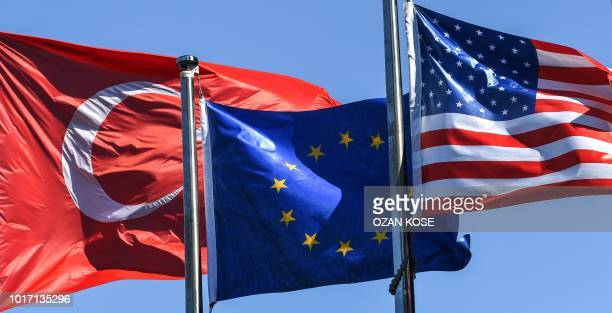 Turkish flag European Union's flag and US flag float in the wind at the financial and business district Maslak on August 15 2018 in Istanbul Stock...
