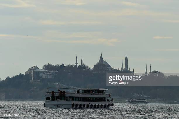 A Turkish flag flies at halfstaff on November 27 2017 at bosphorus coast in Istanbul Turkey began a day of mourning for 305 people killed in the...