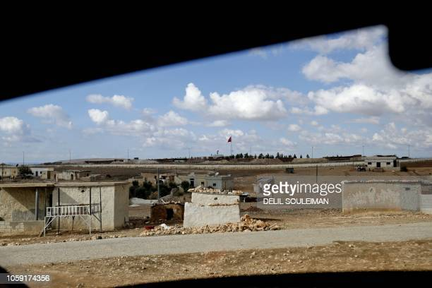 A Turkish flag flutters at a military post in the village of Ashma near the border with Turkey in the Kurdish region of Kobane in northern Syria on...