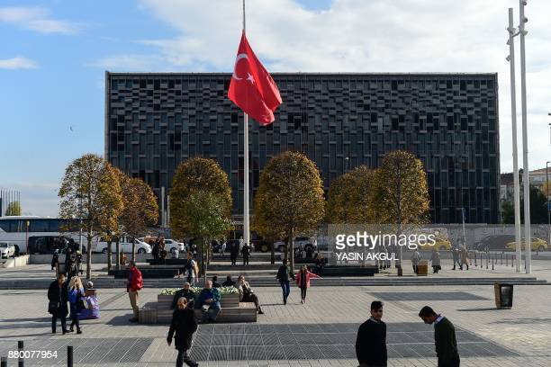 A Turkish flag is at halfstaff on November 27 2017 at Taksim square in Istanbul Turkey began a day of mourning for 305 people killed in the Sinai...