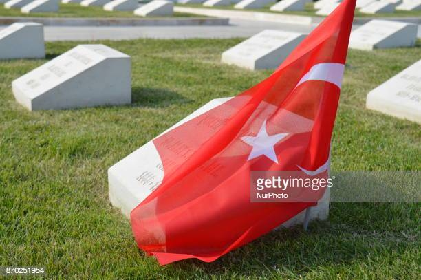 A Turkish flag is placed on the grave of a Turkish soldier at the 57th Infantry Regiment Martyrdom of Turkey on the Gallipoli peninsula in Canakkale...