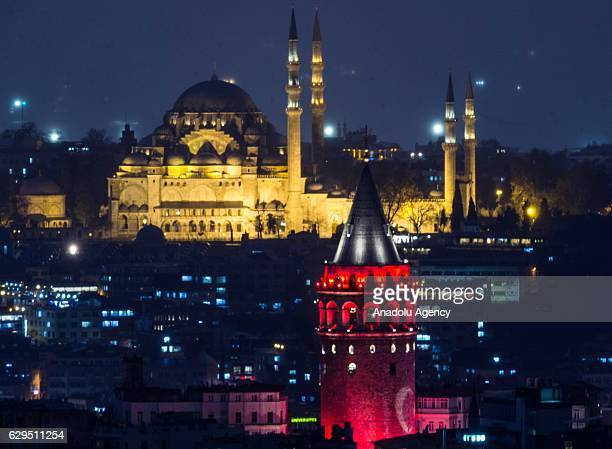 Turkish flag is projected on historical Galata Tower to pay tribute to the twin terrorist attacks victims in Istanbul Turkey on December 13 2016 as...